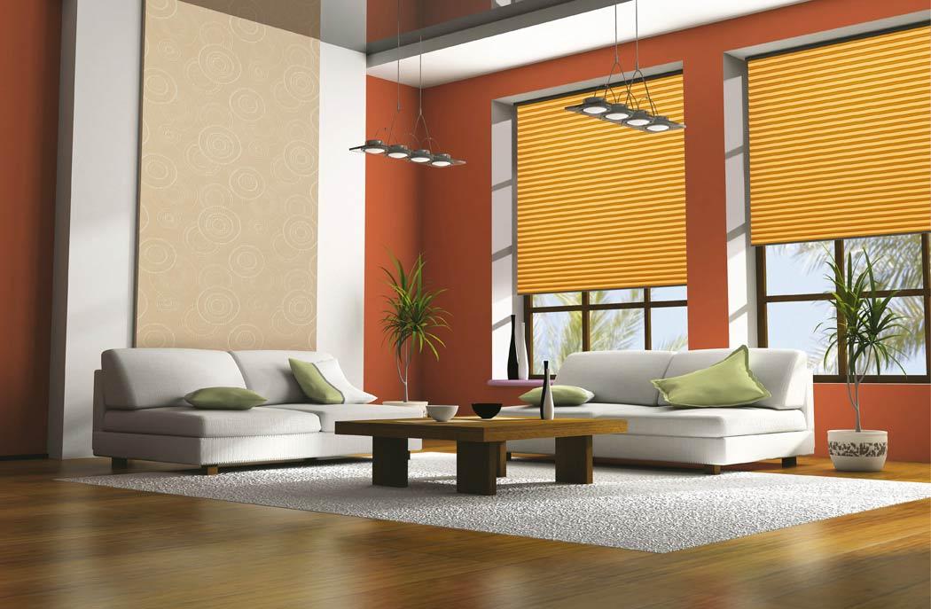 Organgefarbene Plissees passend zur aufheiternden Wohnzimmerfarbe - Dr. Haller + Co. - Selastore®